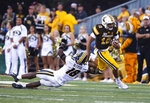 Wyoming quarterback Sean Chambers runs for a touchdown past Missouri defender Joshuah Bledsoe in the second quarter of an NCAA college football game, Saturday, Aug. 31, 2019. in Laramie, Wyo. (AP Photo/Michael Smith)