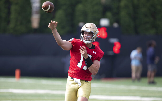 Notre Dame quarterback Jack Coan (17) passes the ball during Notre Dame Fall Camp on Saturday, Aug. 7, 2021, at Irish Athletics Center in South Bend, Ind. (John Mersits/South Bend Tribune via AP)