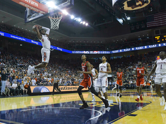 Auburn player Malik Dunbar (4) dunks for two against Georgia during the second half of an NCAA college basketball game Saturday, Jan. 12, 2019, in Auburn, Ala. (AP Photo/Julie Bennett)