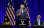 Former Democratic presidential candidate Rep. Seth Moulton, D-Mass., gestures while speaking at the Democratic National Committee's summer meeting Friday, Aug. 23, 2019, in San Francisco. Moulton announced he is dropping from the race. (AP Photo/Ben Margot)
