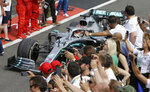 Mercedes driver Lewis Hamilton of Britain steers his car after winning the French Formula One Grand Prix at the Paul Ricard racetrack in Le Castellet, southern France, Sunday, June 23, 2019. (AP Photo/Claude Paris)