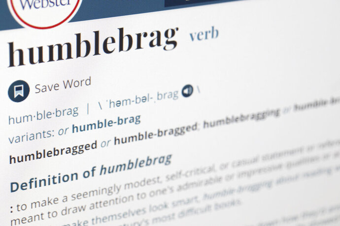 "The word humblebrag is displayed on a computer screen on Friday, Dec. 6, 2019, in New York. Merriam-Webster sums up the humble-brag nicely: ""to make a seemingly modest, self-critical, or casual statement or reference that is meant to draw attention to one's admirable or impressive qualities or achievement."" The dictionary titans say the term has been around since 2002. It was later popularized by the comedian, TV producer and writer Harris Wittels, who died in 2015. (AP Photo/Jenny Kane)"