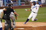 Los Angeles Dodgers' Chris Taylor, right, slides into home to beat the throw to Houston Astros catcher Martin Maldonado, second from left, on a two-run single by Enrique Hernandez, during the fifth inning of a baseball game in Los Angeles, Sunday, Sept. 13, 2020. (AP Photo/Alex Gallardo)