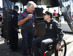 Auto Racing legend Mario Andretti,left, talks with Robert Wickens at the IndyCar Grand Prix of St. Petersburg auto race in St. Petersburg, Fla. Friday, March 8, 2019. Wickens returned to a race track for the first time since he suffered a major spinal cord injury in a crash six months ago. (Dirk Shadd/Tampa Bay Times via AP)