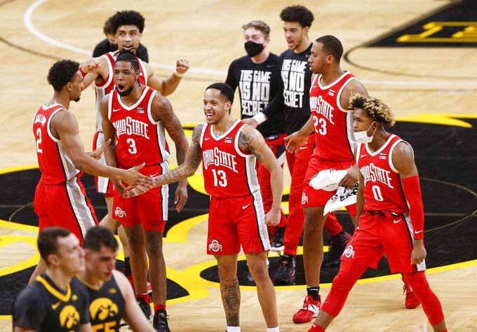 Ohio State players celebrate their win in an NCAA college basketball game against Iowa in Iowa City, Iowa, Thursday, Feb. 4, 2021. (Rebecca F. Miller/The Gazette via AP)