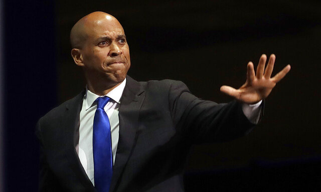 FILE - In this June 1, 2019 file photo, Democratic presidential candidate Sen. Cory Booker, of New Jersey, waves before speaking during the 2019 California Democratic Party State Organizing Convention in San Francisco.  Booker has dropped out of the presidential race after failing to qualify for the December primary debate. (AP Photo/Jeff Chiu)