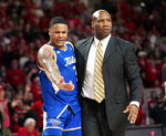 Tulsa assistant coach Kwanza Johnson, right, holds onto Elijah Joiner after Joiner was ejected from the game during the second half of an NCAA college basketball game against Houston Wednesday, Feb. 19, 2020, in Houston. (AP Photo/David J. Phillip)