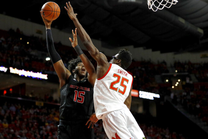 Rutgers center Myles Johnson (15) goes up for a shot against Maryland forward Jalen Smith (25) during the first half of an NCAA college basketball game Tuesday, Feb. 4, 2020, in College Park, Md. (AP Photo/Julio Cortez)