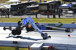 In this photo provided by the NHRA, Leah Pritchett's Top Fuel car breaks apart during the second round of eliminations at the Mopar Express Lane NHRA Midwest Nationals drag races Sunday, Oct. 4, 2020, at World Wide Technology Raceway in Madison, Ill. Pritchett walked away from the crash. (Gary Nastase/Auto Imagery via NHRA via AP)