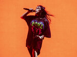 FILE - This April 20, 2019 file photo shows Billie Eilish performing at the Coachella Music & Arts Festival in Indio, Calif. Eilish  scored six Grammy Award nominations, Wednesday, Nov. 20, making the 17-year-old the youngest artist in the history of the Grammys to achieve the feat.  (Photo by Amy Harris/Invision/AP)