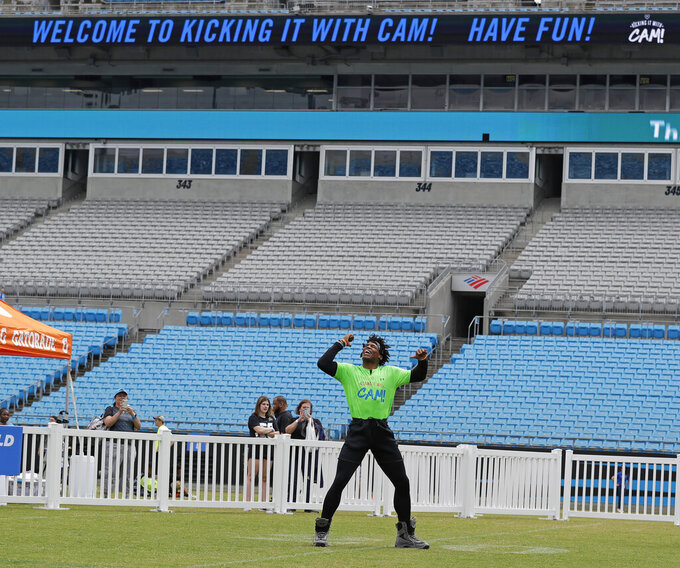 Carolina Panthers Cam Newton dances in the outfield during his charity kickball tournament in Charlotte, N.C., Friday, May 10, 2019. Both Panthers QBs will be action Friday. Meanwhile rookie draft pick QB Will Grier was throwing footballs for the first time as Carolina opens rookie minicamp on the team's practice fields outside the stadium. (AP Photo/Chuck Burton)