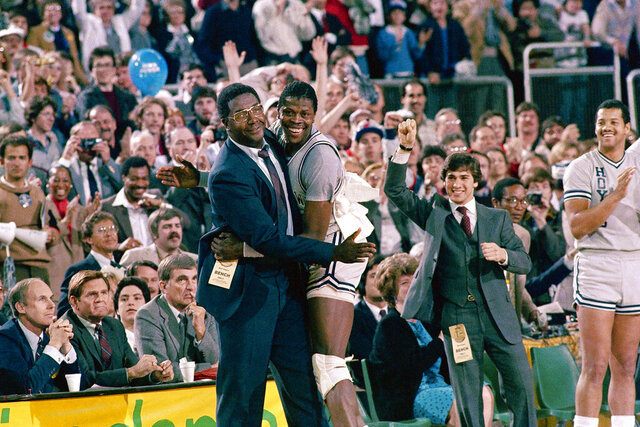 "FILE - In this April 2, 1984, file photo, Georgetown head coach John Thompson, left, gives a happy pat to the most valuable player Patrick Ewing, after Georgetown defeated Houston 84-75 in Seattle. John Thompson, the imposing Hall of Famer who turned Georgetown into a ""Hoya Paranoia"" powerhouse and became the first Black coach to lead a team to the NCAA men's basketball championship, has died. He was 78 His death was announced in a family statement Monday., Aug. 31, 2020. No details were disclosed.(AP Photo/File)"