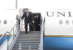 In a picture issued by the Hungarian Ministry of Foreign Affairs and Trade (KKM) US Secretary of State Mike Pompeo, left, arrives at Liszt Ferenc International Airport in Budapest, Hungary, Monday, Feb. 11, 2019. Pompeo is on an official visit to Hungary. (Marton Kovacs/KKM/MTI via AP)