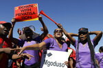 South African Cabin Crew Association and the National Union of Metalworkers members picket at the SAA Airways Park in Kempton Park, South Africa, Friday, Nov. 15, 2019. South Africa's troubled state-owned airline has begun canceling flights after two unions announced their workers would go on strike to protest nearly 1,000 expected job cuts. (AP Photo/Themba Hadebe)