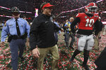 Georgia head coach Kirby Smart and Georgia defensive back Malik Herring (10) walk off the field after the College Football Playoff National Championship game between Georgia and Alabama on Monday, Jan. 8, 2017 in Atlanta, Ga. (AJ Reynolds/Athens Banner-Herald via AP)