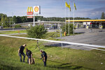 Police work at the site on Sunday Aug. 2, 2020 where a twelve-year-old girl was shot and killed near a petrol station in Botkyrka, south of Stockholm, Sweden. (Naina Helén Jåma/TT via AP)