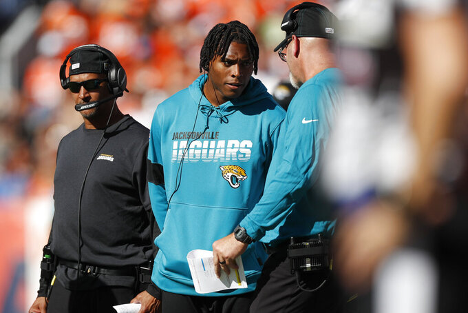 Jacksonville Jaguars cornerback Jalen Ramsey, center, talks with defensive coordinator Todd Wash as he stands on the sidelines during the first half of an NFL football game against the Denver Broncos, Sunday, Sept. 29, 2019, in Denver. (AP Photo/David Zalubowski)