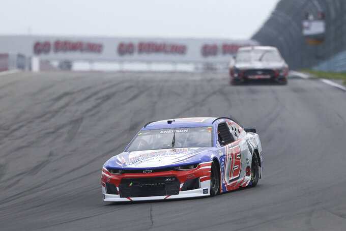Richard Clayton Enerson drives through Turn 1 during a NASCAR Cup Series auto race in Watkins Glen, N.Y., on Sunday, Aug. 8, 2021. (AP Photo/Joshua Bessex)