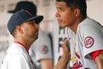 St. Louis Cardinals' bench coach Oliver Marmol talks to starting pitcher Johan Oviedo after he left the game in the fifth inning of a baseball game against the Cincinnati Reds in Cincinnati, Sunday, July 25, 2021. (AP Photo/Bryan Woolston)