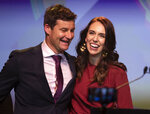 New Zealand Prime Minister Jacinda Ardern, right, is congratulated by her partner Clarke Gayford following her victory speech to Labour Party members at an event in Auckland, New Zealand, Saturday, Oct. 17, 2020. (AP Photo/Mark Baker)