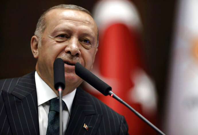 Turkey's President Recep Tayyip Erdogan addresses his ruling party MPs, in Ankara, Turkey, Tuesday, June 25, 2019, two days after Ekrem Imamoglu, the candidate of the secular opposition Republican People's Party, won the election for mayor of Istanbul. Erdogan addressed his AK Party's weekly meeting, the first time he speaks since the Istanbul mayoral election Sunday, which was a big setback for him and his party. (AP Photo/Burhan Ozbilici)
