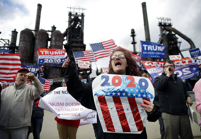 Protesters demonstrate in support of President Donald Trump near a Fox News town-hall style event with U.S. Sen. Bernie Sanders, Monday, April 15, 2019, in Bethlehem, Pa. (AP Photo/Matt Rourke)