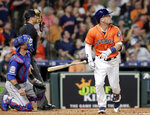 Houston Astros Alex Bregman, right, flips his bat as he watches his home run next to Texas Rangers catcher Jeff Mathis, left, and umpire Dan Iassogna during the third inning of a baseball game Friday, July 19, 2019, in Houston. (AP Photo/Michael Wyke)