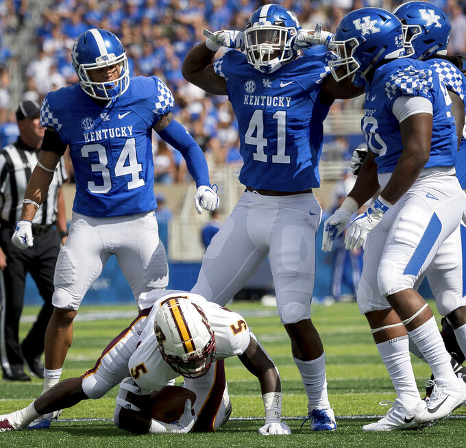 Kentucky linebacker Josh Allen (41), center, and teammates celebrate after tackling Central Michigan running back Jonathan Ward (5) for negative yards in the first half of an NCAA college football game in Lexington, Ky., Saturday, Sept. 1, 2018. (AP Photo/Bryan Woolston)