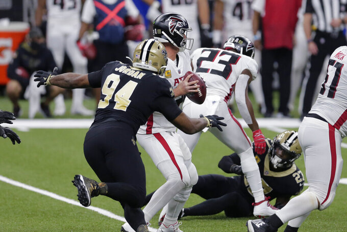 New Orleans Saints defensive end Cameron Jordan (94) closes in to sack Atlanta Falcons quarterback Matt Ryan in the first half of an NFL football game in New Orleans, Sunday, Nov. 22, 2020. (AP Photo/Brett Duke)