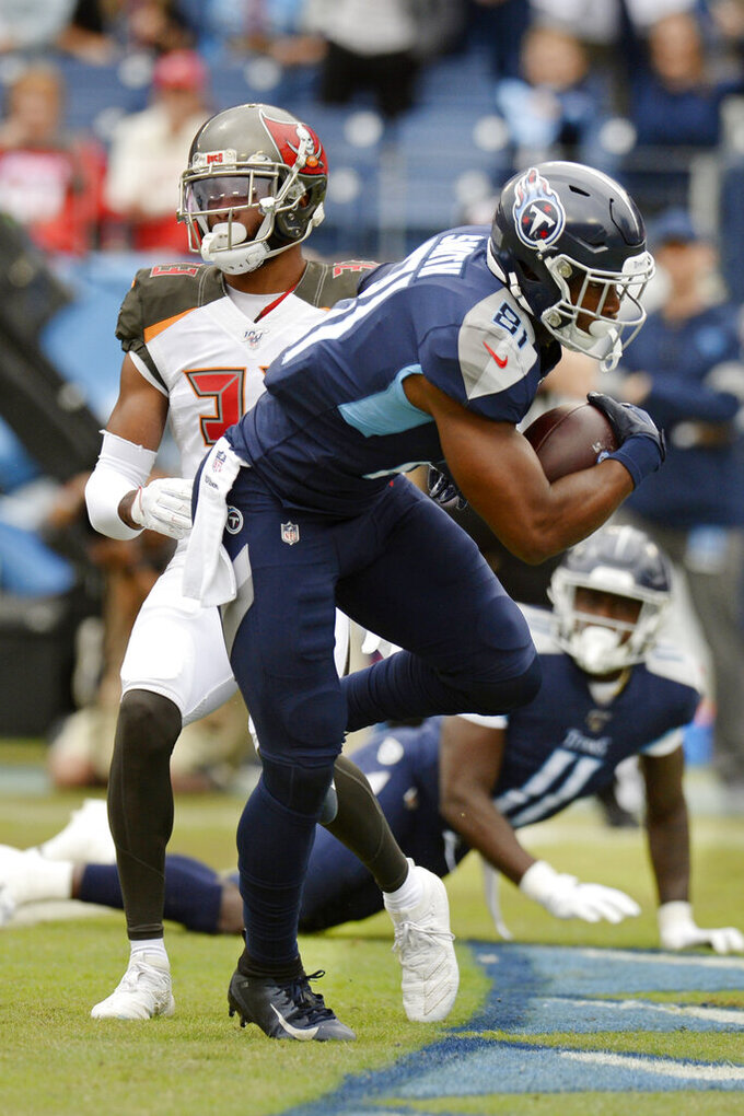 Tennessee Titans tight end Jonnu Smith (81) scores a touchdown against the Tampa Bay Buccaneers in the first half of an NFL football game Sunday, Oct. 27, 2019, in Nashville, Tenn. (AP Photo/Mark Zaleski)