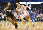 Oklahoma City Thunder forward Abdul Nader (11) drives past Miami Heat forward James Johnson (16) in the second half of an NBA basketball game Monday, March 18, 2019, in Oklahoma City. (AP Photo/Kyle Phillips)