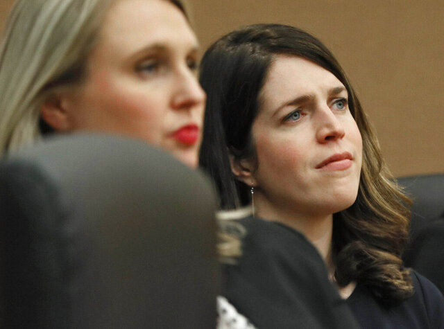 "File-This Dec. 19, 2019, file photo shows Jenna Garland appearing in court in Atlanta. The ex-aide of former Atlanta Mayor Kasim Reed has requested a new trial to appeal her conviction for violating the state's open records laws.  Garland previously served as press secretary under Reed. She was convicted in December on two misdemeanor counts after she directed a subordinate to ""drag out"" a records request that a local TV station had made. (Bob Andres/Atlanta Journal-Constitution via AP,File)"
