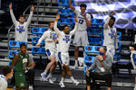 The Creighton bench celebrates in the second half of a second-round game against Ohio in the NCAA men's college basketball tournament at Hinkle Fieldhouse in Indianapolis, Monday, March 22, 2021. (AP Photo/Michael Conroy)