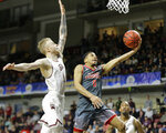 Eastern Washington's Tyler Kidd (0) shoots past Montana's Timmy Falls (1) during an NCAA college basketball game in the championship of the Big Sky Tournament in Boise, Idaho, Saturday, March 16, 2019. (AP Photo/Otto Kitsinger)