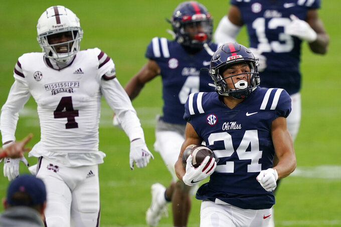Mississippi defensive back Deane Leonard (24) is pursued by Mississippi State wide receiver Malik Heath (4) after recovering a fumble during the first half of an NCAA college football game, Saturday, Nov. 28, 2020, in Oxford, Miss. (AP Photo/Rogelio V. Solis)