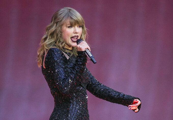 "FILE - In this June 22, 2018, file photo, singer Taylor Swift performs on stage in concert at Wembley Stadium in London. Swift is canceling all of her performances and appearances for the rest of the year because of the coronavirus pandemic. ""With many events throughout the world already cancelled, and upon direction from health officials in an effort to keep fans safe and help prevent the spread of COVID-19, sadly the decision has been made to cancel all Taylor Swift live appearances and performances this year,"" Swift's representative said in a statement released Friday.  (Photo by Joel C Ryan/Invision/AP, File)"