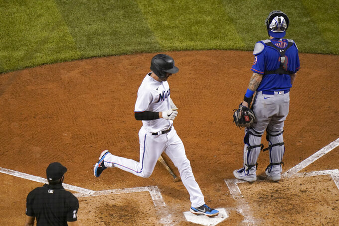 Miami Marlins' Matt Joyce scores on a double hit by Jesus Aguilar during the fourth inning of a baseball game against the New York Mets, Tuesday, Aug. 18, 2020, in Miami. (AP Photo/Lynne Sladky)