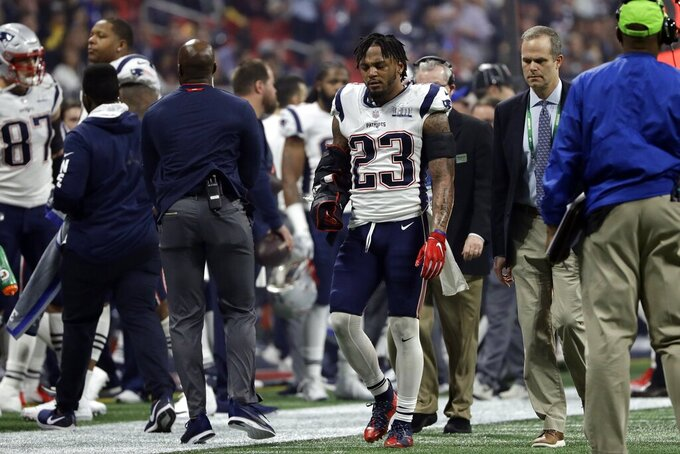 New England Patriots' Patrick Chung (23) leaves the game after he injured his right arm, during the second half of the NFL Super Bowl 53 football game against the Los Angeles Rams, Sunday, Feb. 3, 2019, in Atlanta. (AP Photo/Frank Franklin II)