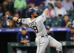 San Diego Padres' Austin Hedges watches his two-run home run off Colorado Rockies starting pitcher Jeff Hoffman during the second inning of a baseball game Friday, Sept. 13, 2019, in Denver. (AP Photo/David Zalubowski)