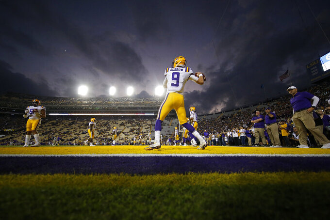 LSU quarterback Joe Burrow (9), a senior who is considered a frontrunner for the Heisman Trophy, warms up for his last NCAA college football game in Tiger Stadium, against Texas A&M in Baton Rouge, La., Saturday, Nov. 30, 2019. (AP Photo/Gerald Herbert)