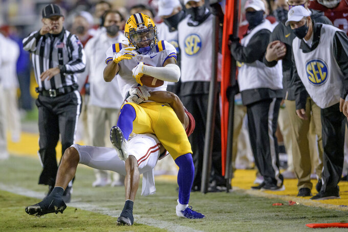 LSU wide receiver Kayshon Boutte, top, tries to get a first down against Alabama defensive back Josh Jobe, bottom, during the first half of an NCAA college football game in Baton Rouge, La., Saturday, Dec. 5, 2020. (AP Photo/Matthew Hinton)