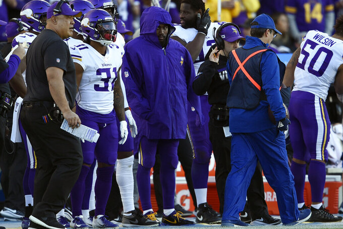 Minnesota Vikings running back Dalvin Cook, center, looks on from the sideline during the second half of an NFL football game against the Los Angeles Chargers, Sunday, Dec. 15, 2019, in Carson, Calif. (AP Photo/Kelvin Kuo)