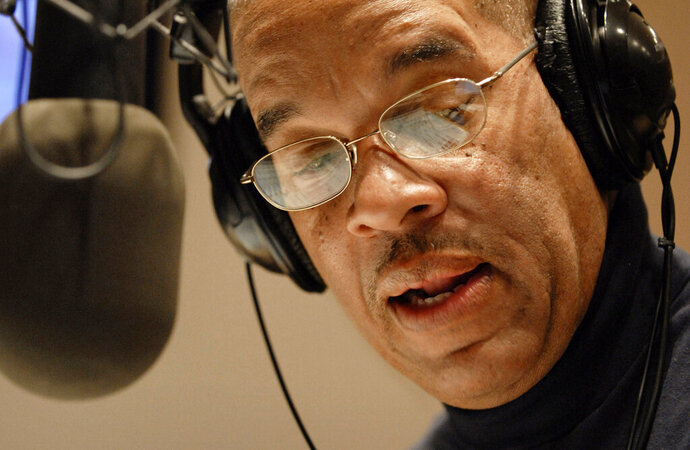 FILE - In this Jan. 24, 2009, file photo, radio host Jose Masso introduces a song during the bilingual