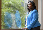 Yolanda Ogbolu, a nurse researcher at the University of Maryland, Baltimore, who advocated for two relatives during their COVID-19 hospital stays, looks out a window at the university's nursing school on Friday, June 11, 2021, in Baltimore. Government health officials say Native Americans, Latinos and Black people are two to three times more likely than whites to die of COVID-19. (AP Photo/Steve Ruark)