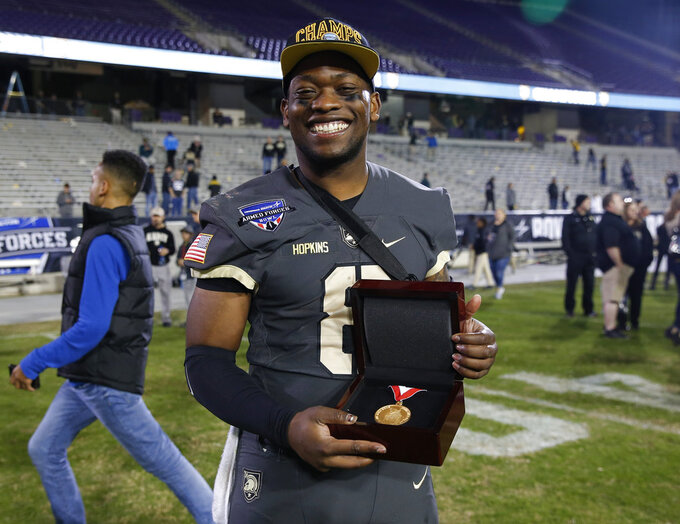 Army quarterback Kelvin Hopkins Jr. poses for a photo with his MVP award following Army's 70-14 win over Houston in the Armed Forces Bowl NCAA college football game Saturday, Dec. 22, 2018, in Fort Worth, Texas. (AP Photo/Jim Cowsert)