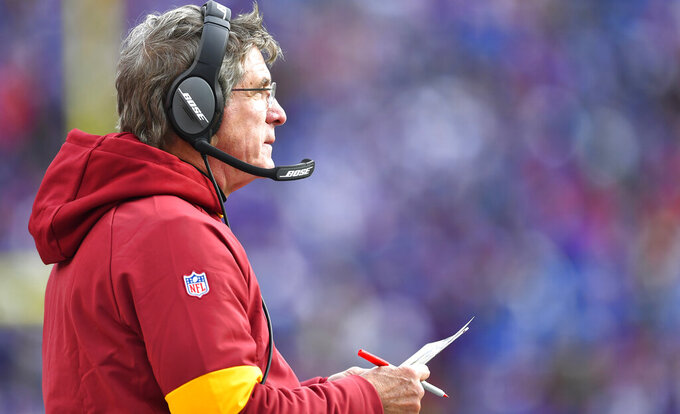 Washington Redskins head coach Bill Callahan watches during the second half of an NFL football game against the Buffalo Bills, Sunday, Nov. 3, 2019, in Orchard Park, N.Y. (AP Photo/Adrian Kraus)