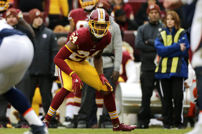 FILE - In this Dec. 24, 2017, file photo, Washington Redskins cornerback Josh Norman (24) looks across the line of scrimmage during an NFL football game against the Denver Broncos,  in Landover, Md. What a week for Washington Redskins cornerback Josh Norman. A benching during a blowout. Criticism from a former teammate. Barbs from an opposing receiver. And what better way to cap it all off than a matchup Sunday against Cam Newton and the rest of the visiting Carolina Panthers, the club that abruptly parted with Norman two years ago. (AP Photo/Mark Tenally, File)