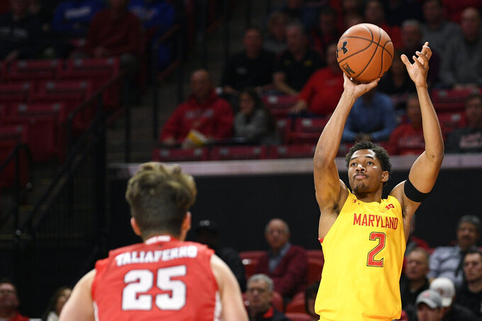 Maryland guard Aaron Wiggins (2) shoots in front of Fairfield guard Landon Taliaferro (25) during the first half of an NCAA college basketball game, Tuesday, Nov. 19, 2019, in College Park, Md. (AP Photo/Nick Wass)