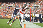 Cleveland Browns wide receiver Odell Beckham Jr. (13) canno hold onto the ball as Chicago Bears cornerback Jaylon Johnson (33) knocks him out of bounds for an incompletion during the second half of an NFL football game, Sunday, Sept. 26, 2021, in Cleveland. (AP Photo/David Dermer)