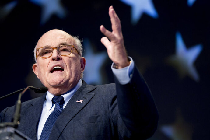"""FILE - In this May 5, 2018, file photo, Rudy Giuliani, an attorney for President Donald Trump, speaks at the Iran Freedom Convention for Human Rights and democracy in Washington. Giuliani is categorically ruling out the possibility of a presidential interview with special counsel Robert Mueller. Giuliani told """"Fox News Sunday"""" that an interview would happen """"over my dead body."""" (AP Photo/Andrew Harnik, File)"""